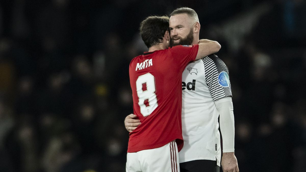 Manchester United's Juan Mata (left) embraces Derby County's Wayne Rooney during the FA Cup Fifth Round match between Derby County and Manchester United at Pride Park on March 5, 2020 in Derby, England