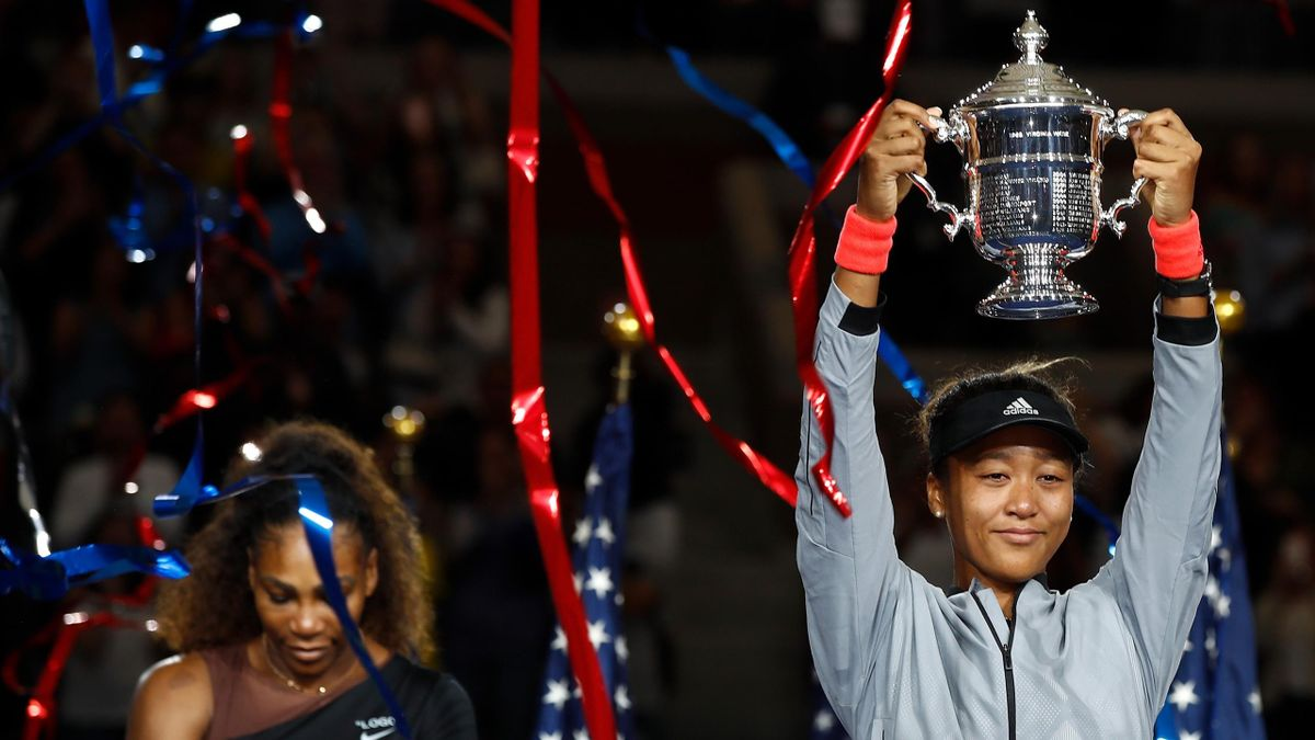 Naomi Osaka of Japan poses with the championship trophy after winning the Women's Singles finals match against Serena Williams of the United States on Day Thirteen of the 2018 US Open at the USTA Billie Jean King National Tennis Center