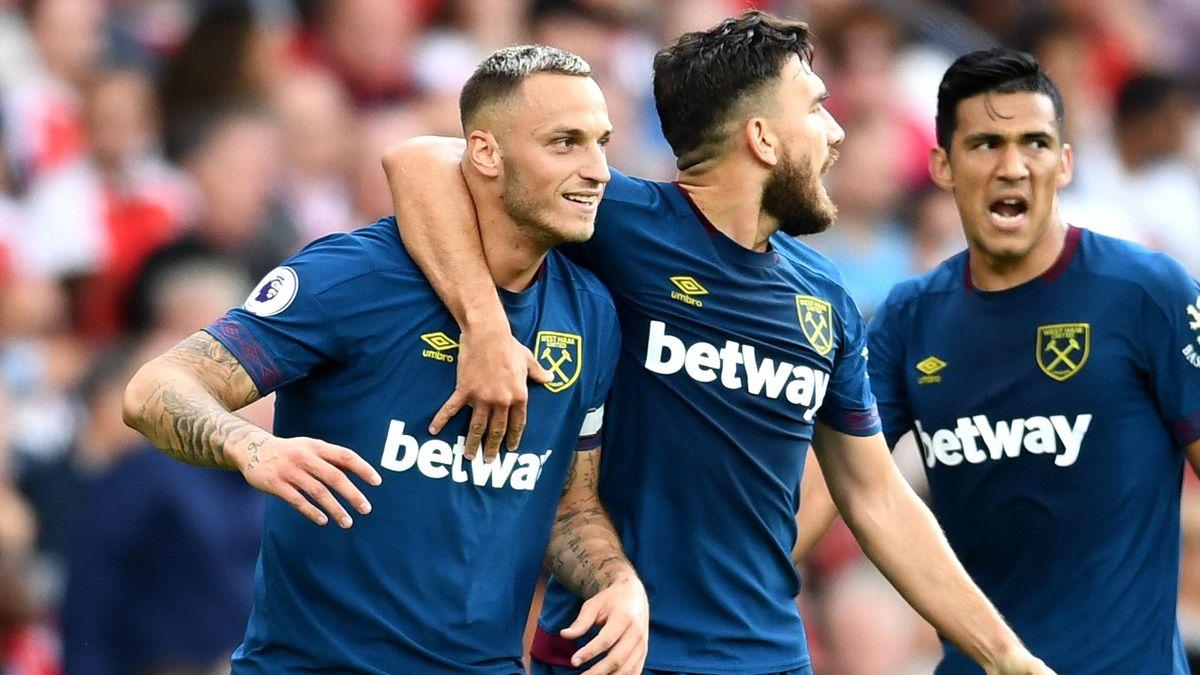 Marko Arnautovic of West Ham United celebrates with teammates