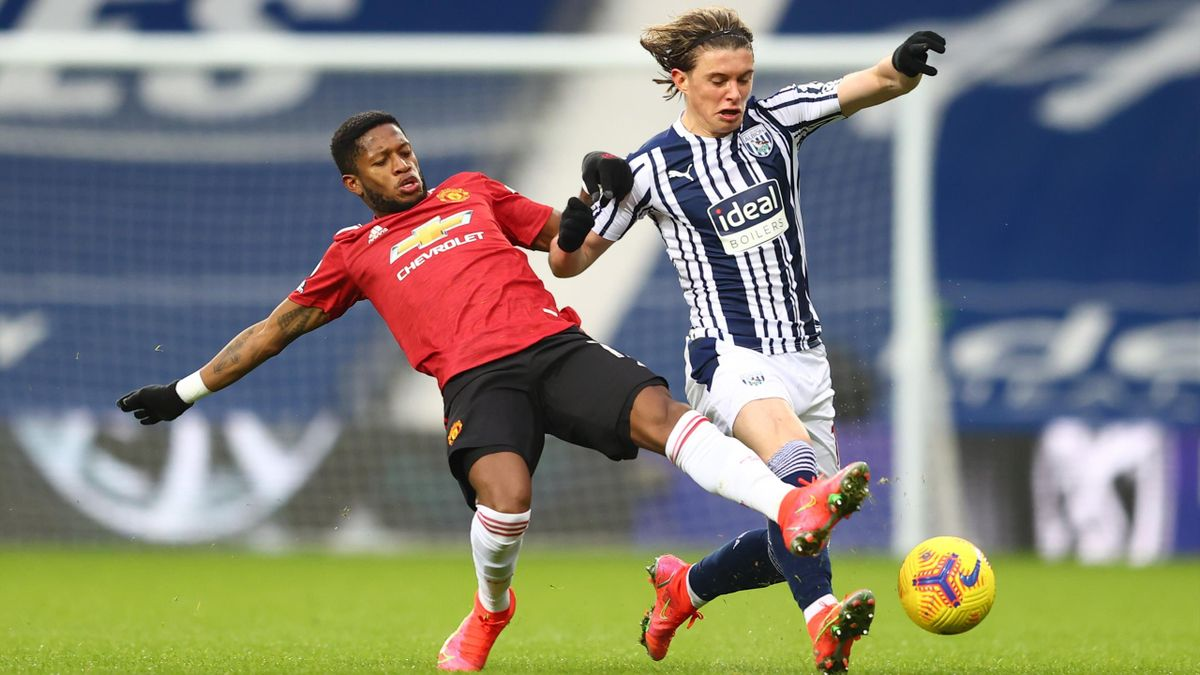 WEST BROMWICH, ENGLAND - FEBRUARY 14: Conor Gallagher of West Bromwich Albion is challenged by Fred of Manchester United during the Premier League match between West Bromwich Albion and Manchester United at The Hawthorns on February 14, 2021 in West Bromw