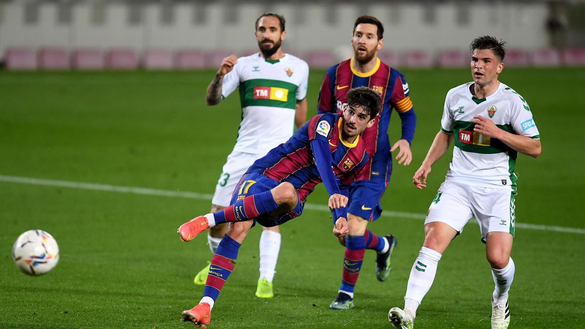 Francisco Trincao of FC Barcelona shoots during the La Liga Santader match between FC Barcelona and Elche CF at Camp Nou on February 24, 2021 in Barcelona, Spain.