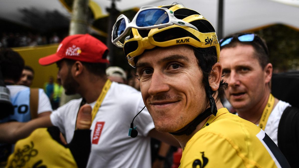 Tour de France winner Great Britain's Geraint Thomas wearing the overall leader's yellow jersey smiles