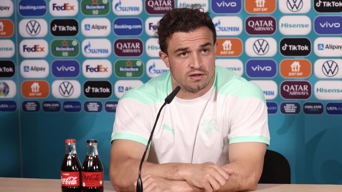 In this handout picture provided by UEFA, Xherdan Shaqiri of Switzerland speaks to the media during the Switzerland Press Conference ahead of the UEFA Euro 2020 Quarter Final match between Spain and Switzerland at Petrovski Stadium on July 01, 2021 in Sai