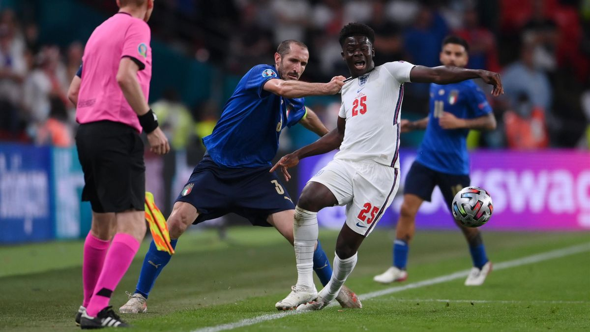 Giorgio Chiellini (left; Italy) and Bukayo Saka (England) - EURO 2020