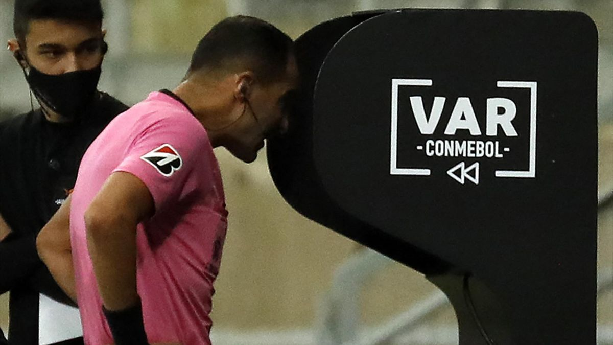Uruguayan referee Esteban Ostojich checks the VAR during the Copa Libertadores round of 16 second leg football match between Brazil's Atletico Mineiro and Argentina's Boca Juniors at the Minerao Stadium in Belo Horizonte, Brazil on July 20, 2021.