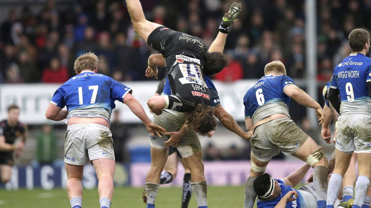 Alec Hepburn of Exeter Chiefs on top of Schalk Brits of Saracens.