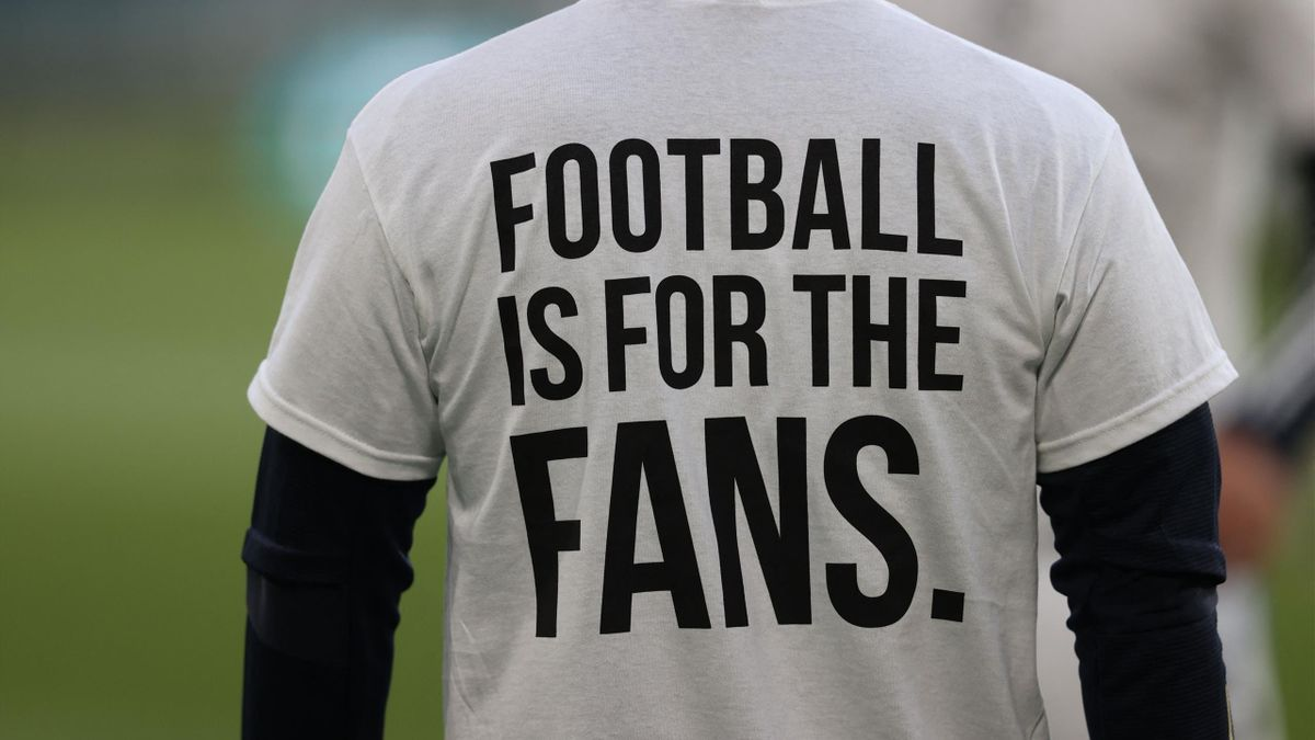 A Leeds United player wears a T-shirt with a slogan against the proposed new European Super League