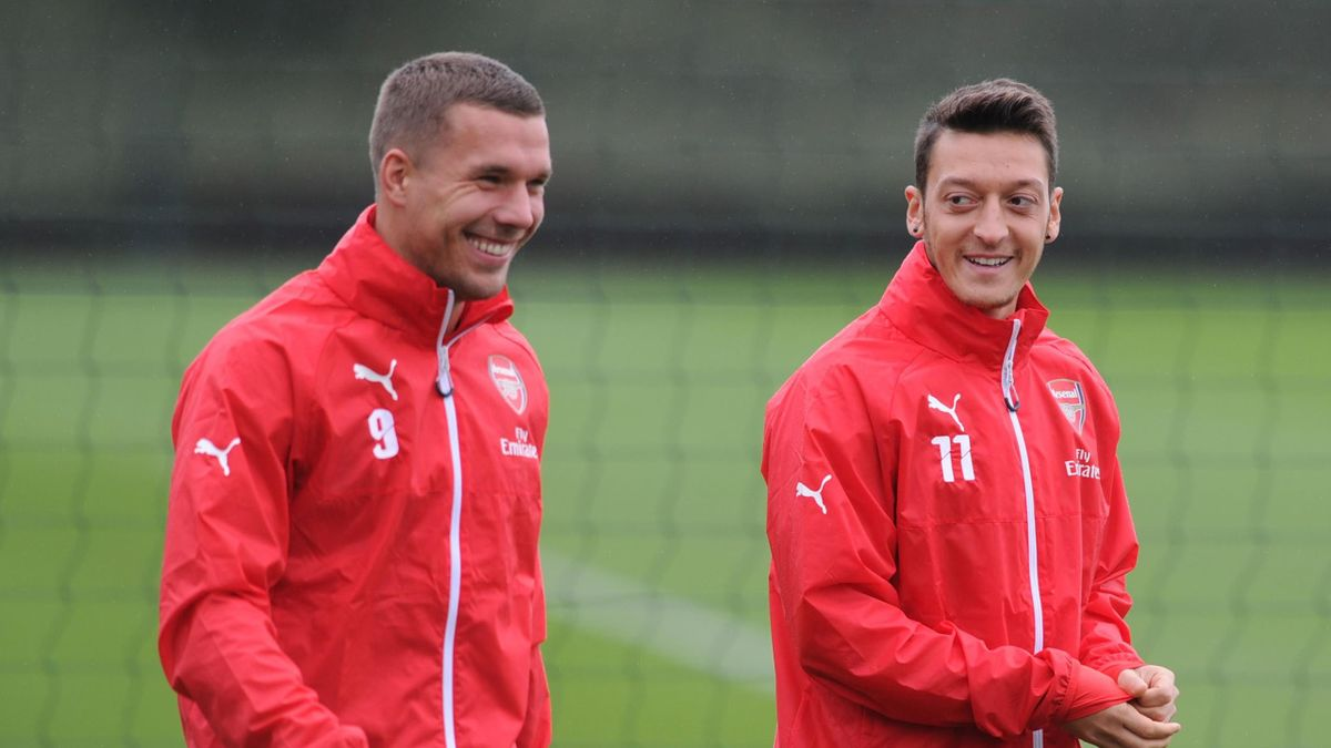 Lukas Podolski (L) and Mesut Ozil (R)