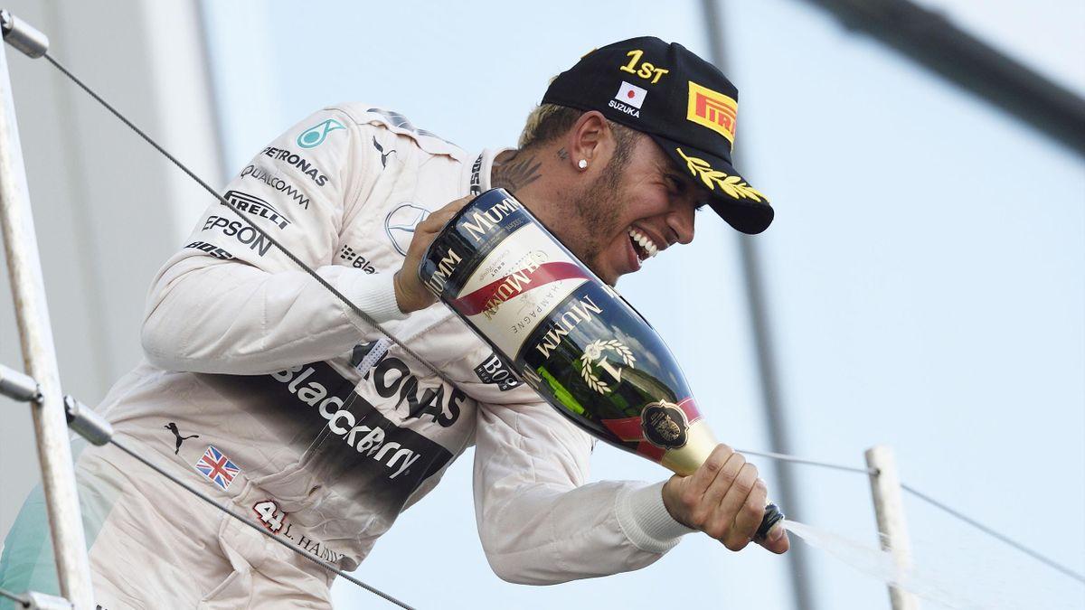 Lewis Hamilton of Mercedes celebrates his win on the podium