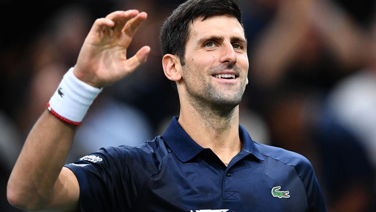Novak Djokovic smiles on the court