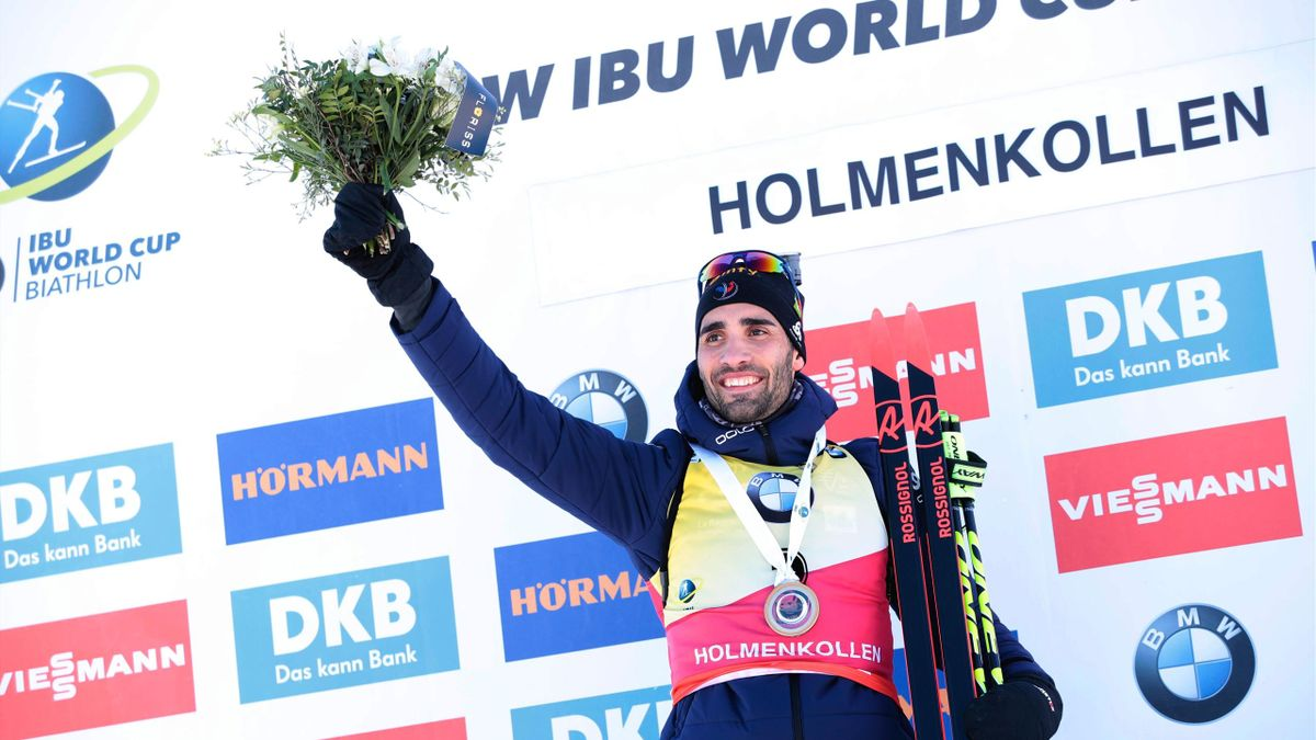 Martin Fourcade from France celebrates on the podium after winning the IBU Biathlon World Cup Men 12,5 km Pursuit Competition in Holmenkollen, Oslo, March 17, 2018.