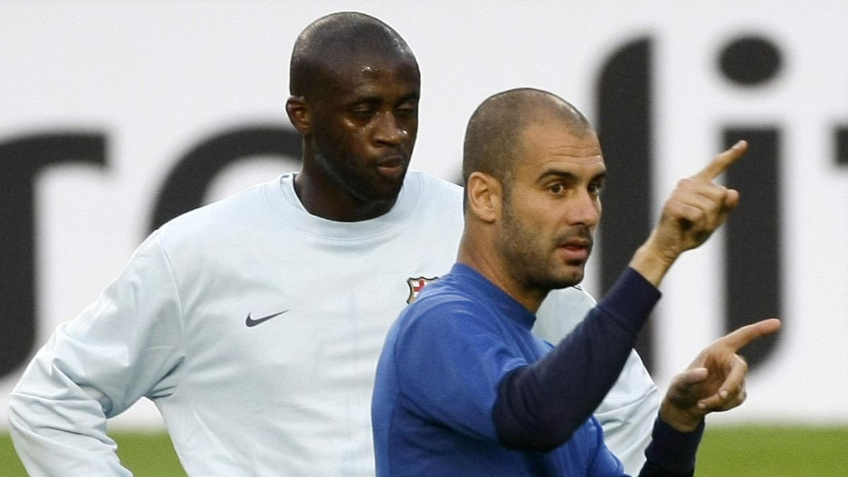 Pep Guardiola appears to show Yaya Toure the exit door while at Barcelona
