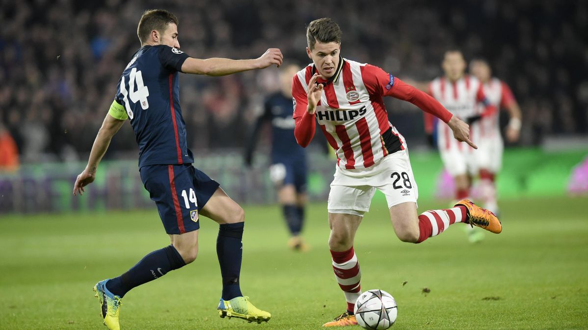 Atletico Madrid's midfielder Gabi (L) and PSV Eindhoven's midfielder Marco van Ginkel fight for the ball during the UEFA Champions League round of 16 first leg football match between PSV Eindhoven and Atletico Madrid at the Philips Stadium in Eindhoven on