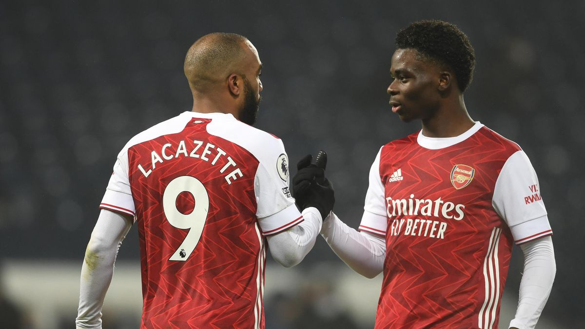 Alex Lacazette celebrates scoring the 3rd Arsenal goal with (R) Bukayo Saka during the Premier League match between West Bromwich Albion and Arsenal at The Hawthorns on January 02, 2021 in West Bromwich