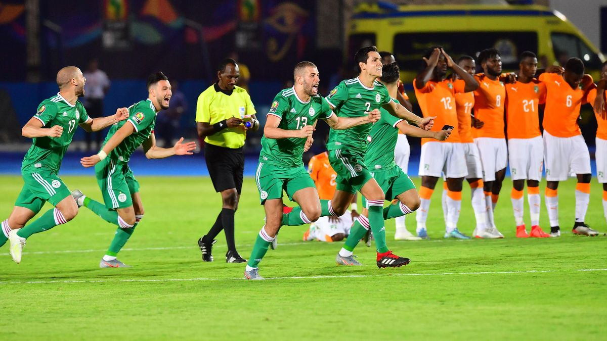 Algerian players celebrate after winning the 2019 Africa Cup of Nations (CAN) quarter final football match between Ivory Coast and Algeria