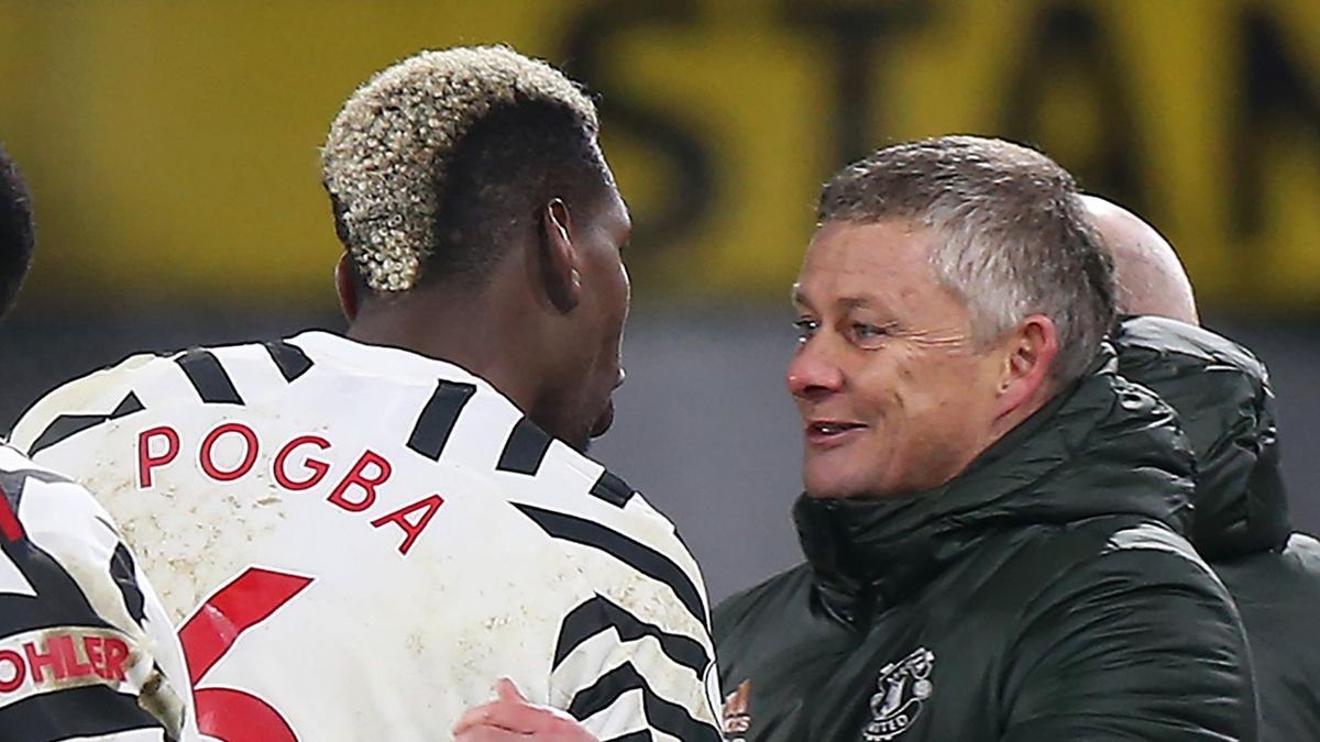 Paul Pogba (L) and Ole Gunnar Solskjaer (R)
