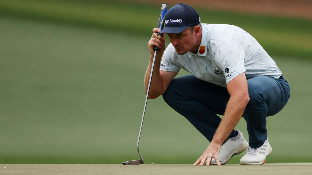 Justin Rose of England looks over a putt on the 15th green during the first round of the Masters at Augusta National Golf Club on April 08, 2021 in Augusta, Georgia.