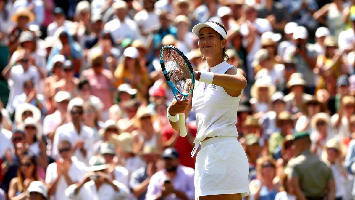 Garbine Muguruza of Spain celebrates after defeating Naomi Broady of Great Britain in their Ladies' Singles first round match on day two of the Wimbledon Lawn Tennis Championships