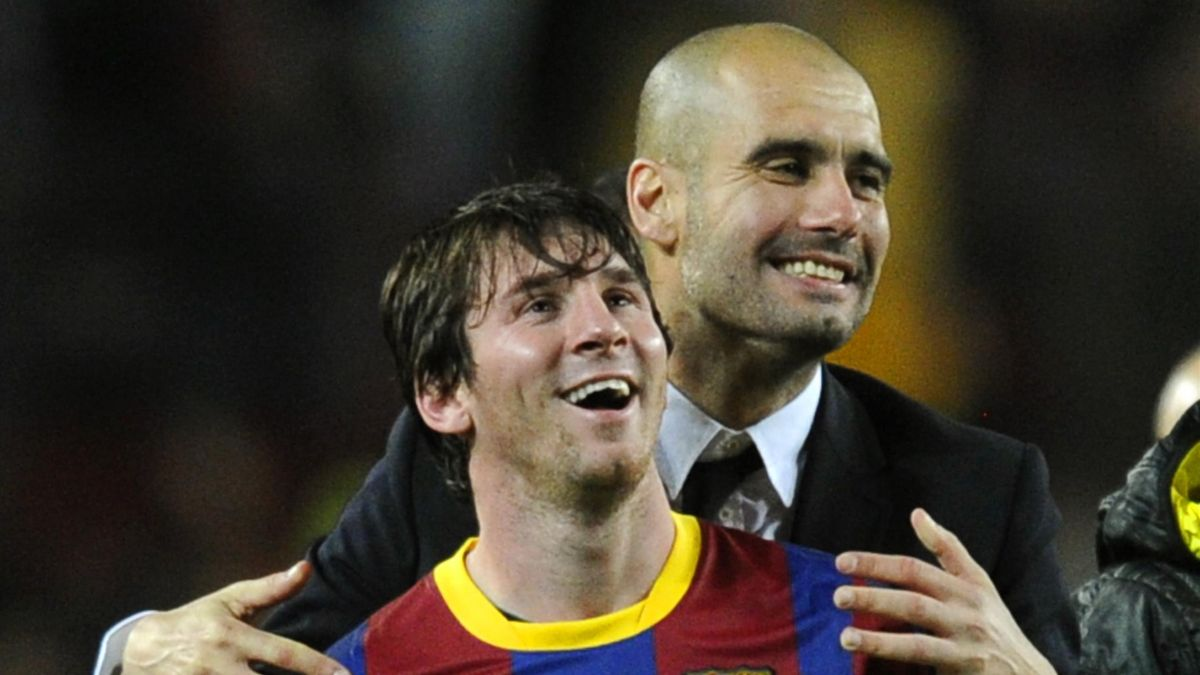 Josep Guardiola (R) celebrates with Lionel Messi
