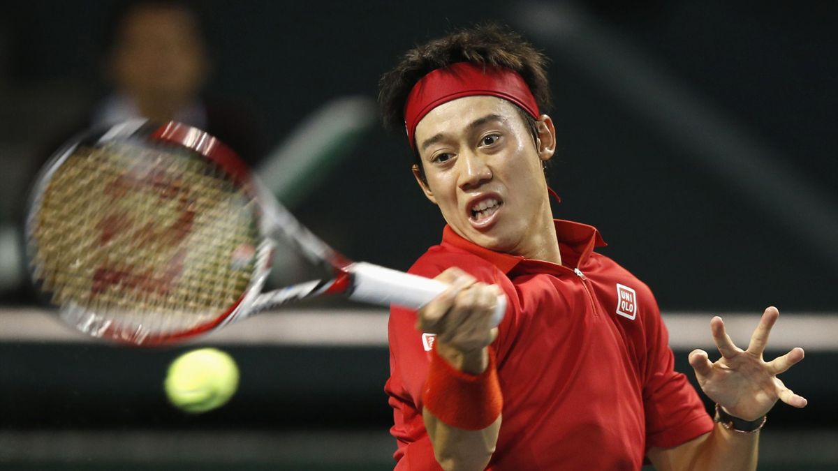 Japan's Kei Nishikori returns a shot against Canada's Frank Dancevic during their Davis Cup world group first round tennis match in Tokyo February 2, 2014 (Reuters)