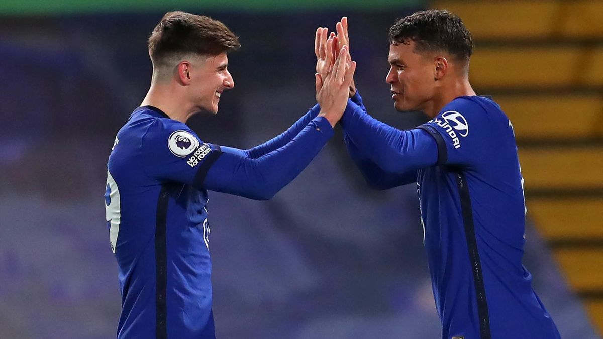 Thiago Silva (R) celebrates with Chelsea's English midfielder Mason Mount (L) after scoring the opening goal of the English Premier League football match between Chelsea and West Ham