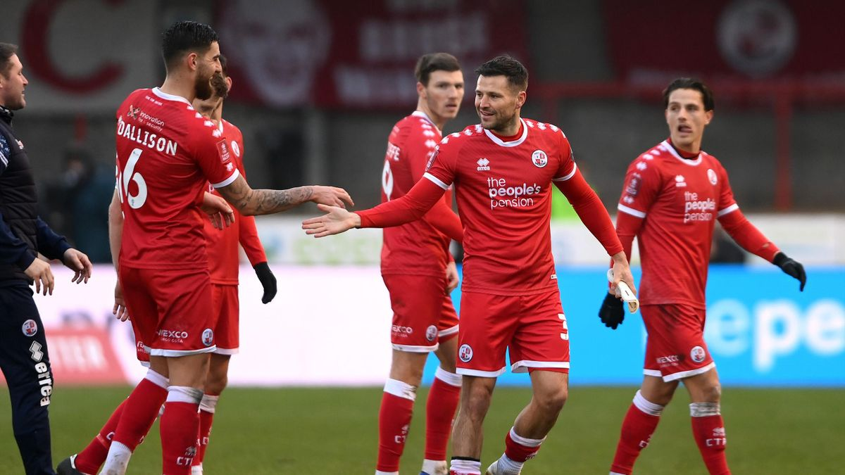 Mark Wright of Crawley Town celebrates victory with team mate Tom Dallison (L) following the FA Cup Third Round match between Crawley Town and Leeds United at The Peoples Pension Stadium on January 10, 2021 in Crawley, England