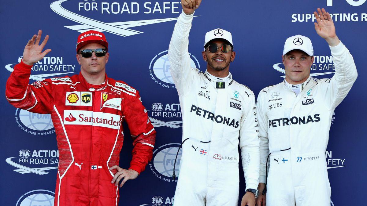 Top three qualifiers Lewis Hamilton of Great Britain and Mercedes GP, Valtteri Bottas of Finland and Mercedes GP and Kimi Raikkonen of Finland