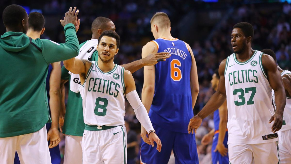 Shane Larkin #8 of the Boston Celtics and Semi Ojeleye #37 celebrate during a New York Knicks time out in the first half at TD Garden on October 24, 2017 in Boston, Massachusetts.