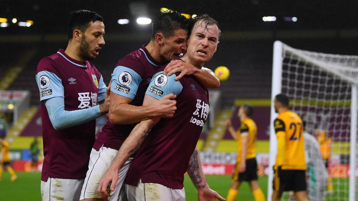 Ashley Barnes of Burnley celebrates with teammates Ashley Westwood and Dwight McNeil after scoring their team's first goal during the Premier League match between Burnley and Wolverhampton Wanderers at Turf Moor