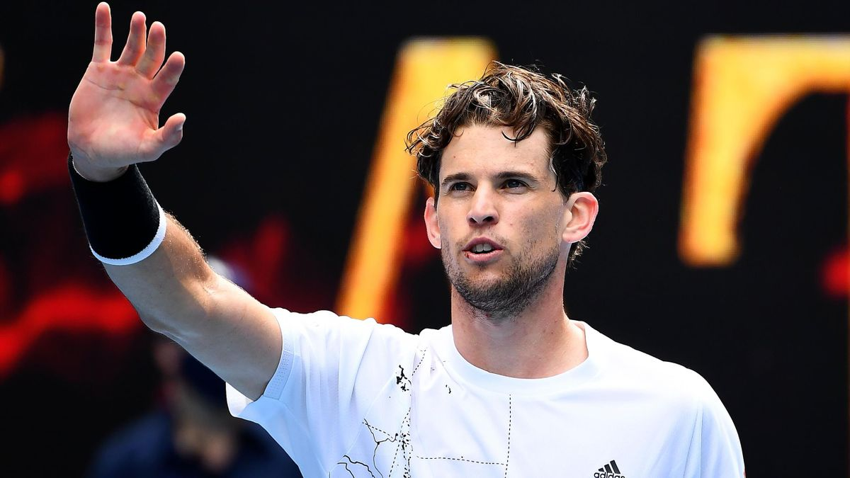 Austria's Dominic Thiem (R) celebrates after winning against Kazakhstan's Mikhail Kukushkin during their men's singles match on day one of the Australian Open tennis tournament in Melbourne