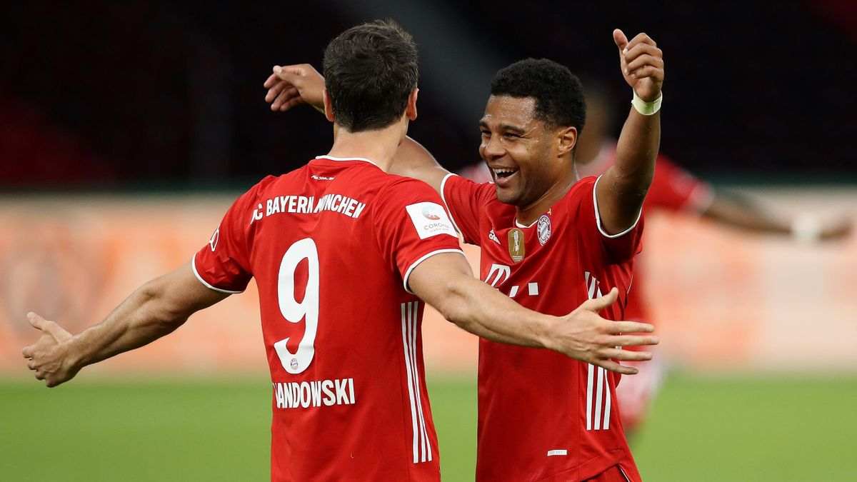 Robert Lewandowski of FC Bayern Muenchen celebrates with teammate Serge Gnabry of FC Bayern Muenchen after scoring his team's third goal during the DFB Cup final match between Bayer 04 Leverkusen and FC Bayern Muenchen at Olympiastadion on July 04
