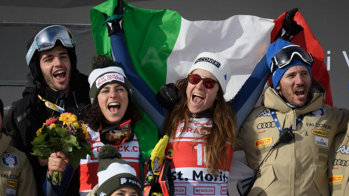 Italy's Sofia Goggia (c) celebrates her victory with her teammate second place Italy's Federica Brignone (L), after the Women's Super G race during the FIS Alpine Ski World Cup on December 14, 2019, in Saint Moritz