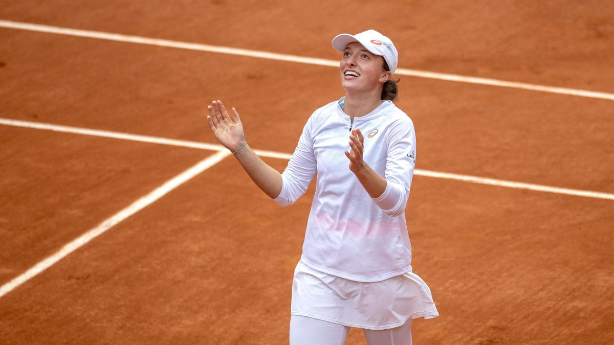 Iga Swiatek of Poland celebrates her victory against Sofia Kenin of the United States in the Singles Final on Court Philippe-Chatrier during the French Open Tennis Tournament at Roland Garros
