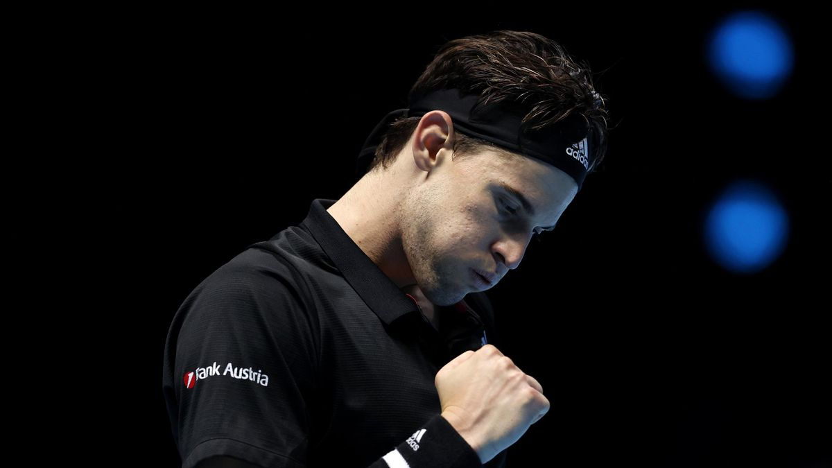 Dominic Thiem of Austria celebrates winning match point during his singles match against Rafael Nadal of Spain during day three of the Nitto ATP World Tour Finals at The O2 Arena on November 17, 2020 in London, England.