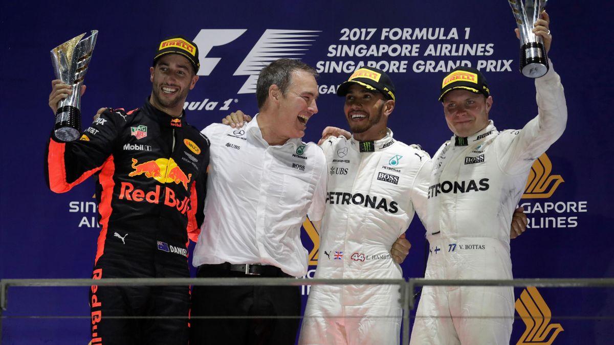 Mercedes' Lewis Hamilton celebrates winning the race on the podium with Red Bull's Daniel Ricciardo and Mercedes' Valtteri Bottas