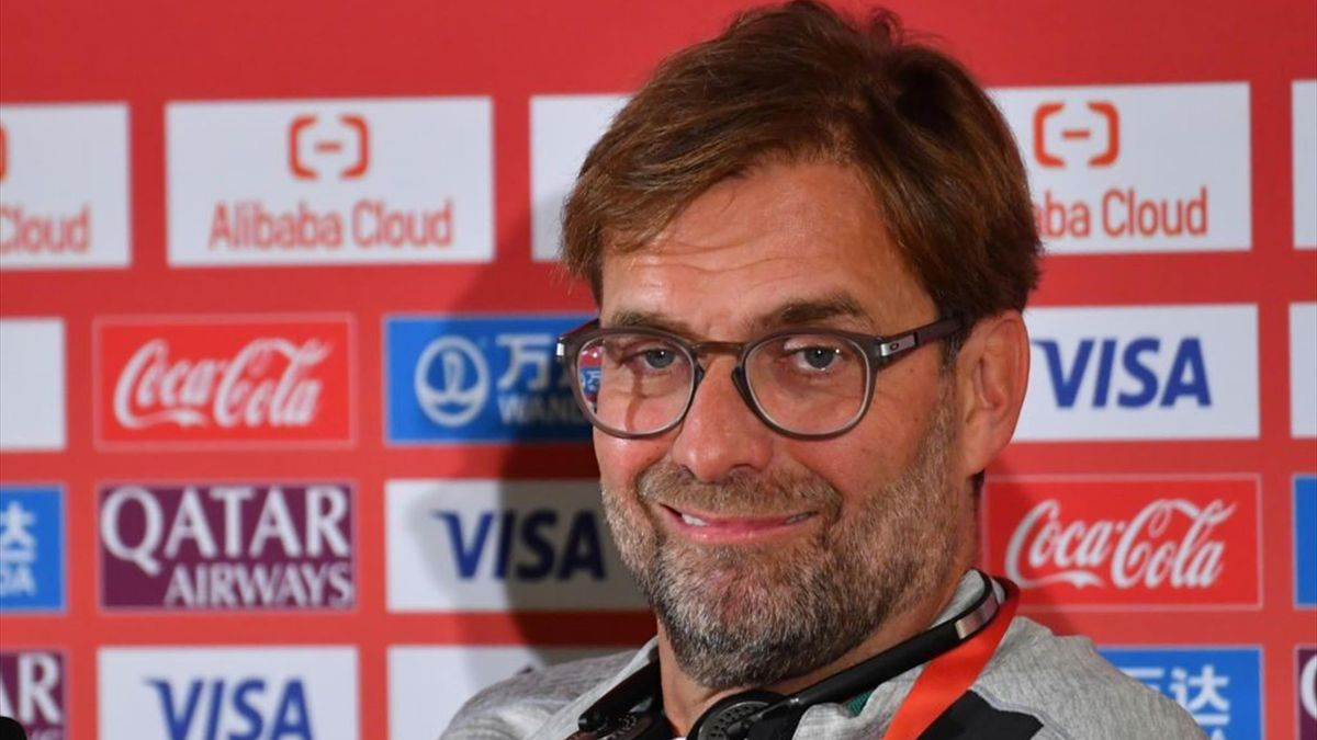 Jurgen Klopp oversees his side in Doha while the reserves play back home
