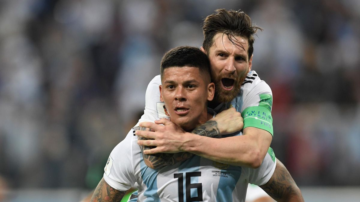 Argentina's defender Marcos Rojo (lower) celebrates his goal with Argentina's forward Lionel Messi during the Russia 2018 World Cup Group D football match between Nigeria and Argentina at the Saint Petersburg Stadium in Saint Petersburg on June 26, 2018.