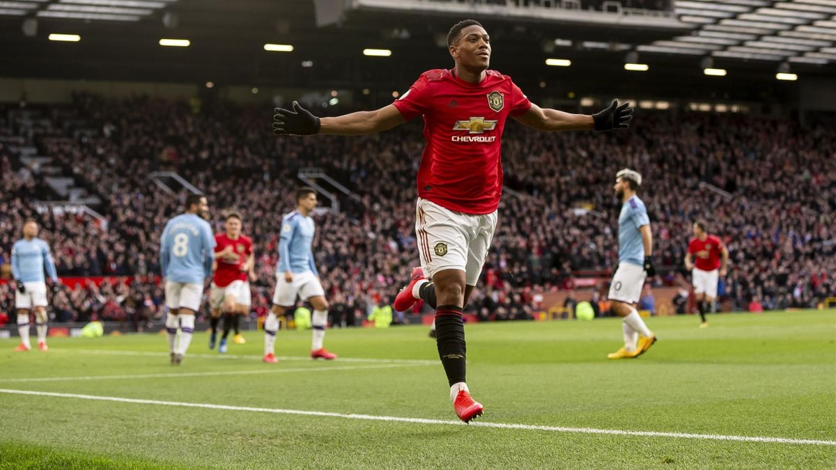Anthony Martial  celebrates after scoring their first goal to make the score 1-0 during the Premier League match between Manchester United and Manchester City at Old Trafford on March 8, 2020 in Manchester, United Kingdom.