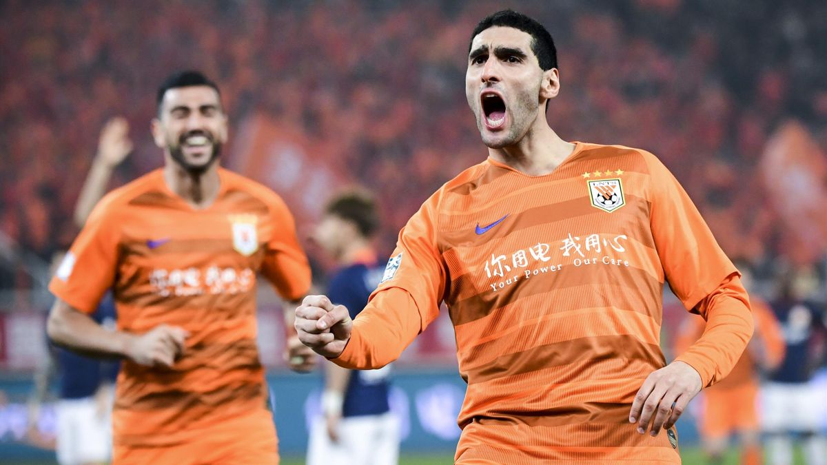 Marouane Fellaini of Shandong Luneng celebrates a goal during the 2019 Chinese Super League match between Shandong Luneng and Beijing Renhe at Luneng Stadium on March 1