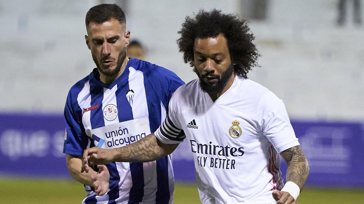 Real Madrid's Marcelo holds off a challenge