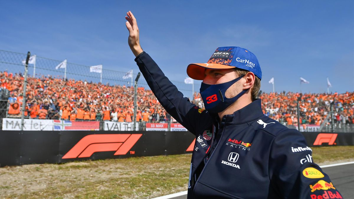 Max Verstappen of Netherlands and Red Bull Racing waves to the crowd on the drivers parade ahead of the F1 Grand Prix of The Netherlands at Circuit Zandvoort on September 05, 2021 in Zandvoort, Netherlands