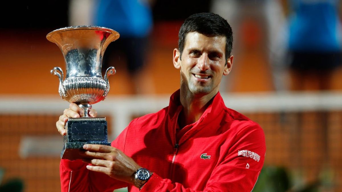 Novak Djokovic of Serbia poses with the trophy after winning his men's final match against Diego Schwartzman of Argentina during day eight of the Internazionali BNL d'Italia at Foro Italico on September 21, 2020 in Rome