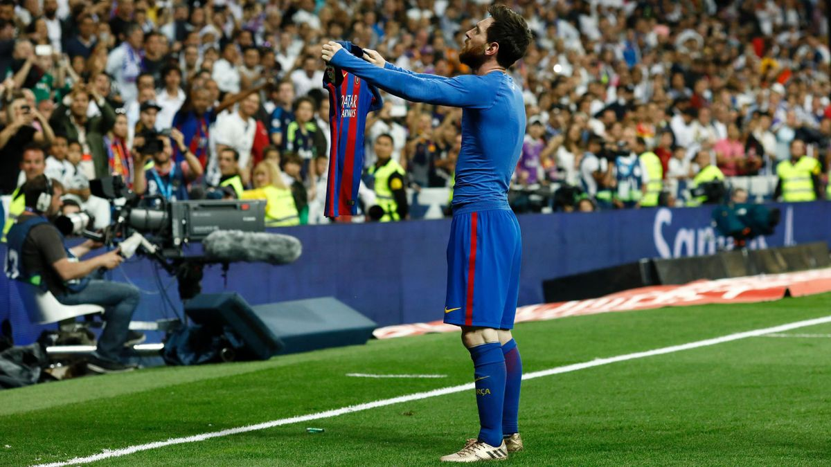Barcelona's Argentinian forward Lionel Messi celebrates after scoring during the Spanish league Clasico football match Real Madrid CF vs FC Barcelona at the Santiago Bernabeu stadium in Madrid on April 23, 2017
