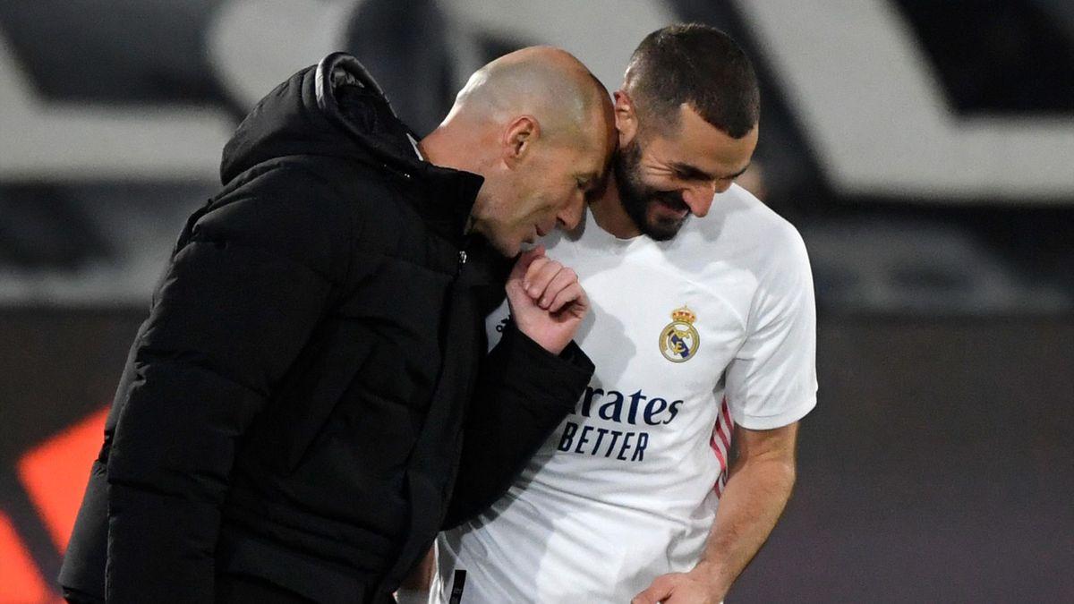 Karim Benzema (R) celebrates with Zinedine Zidane