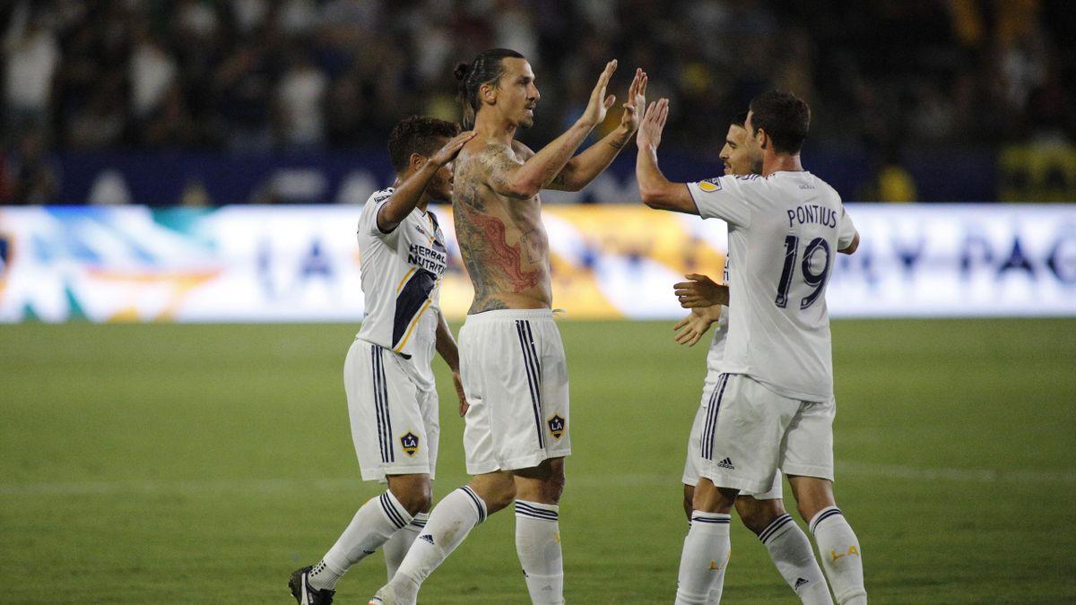 Zlatan Ibrahimovic #9 of the Los Angeles Galaxy high-fives teammate Chris Pontius #19 at StubHub Center