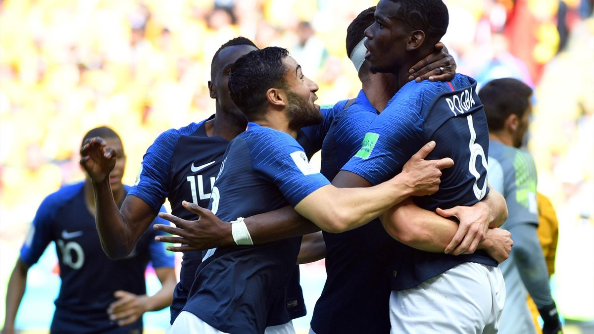 France's midfielder Paul Pogba (R) celebrates with teammates after scoring their second goal