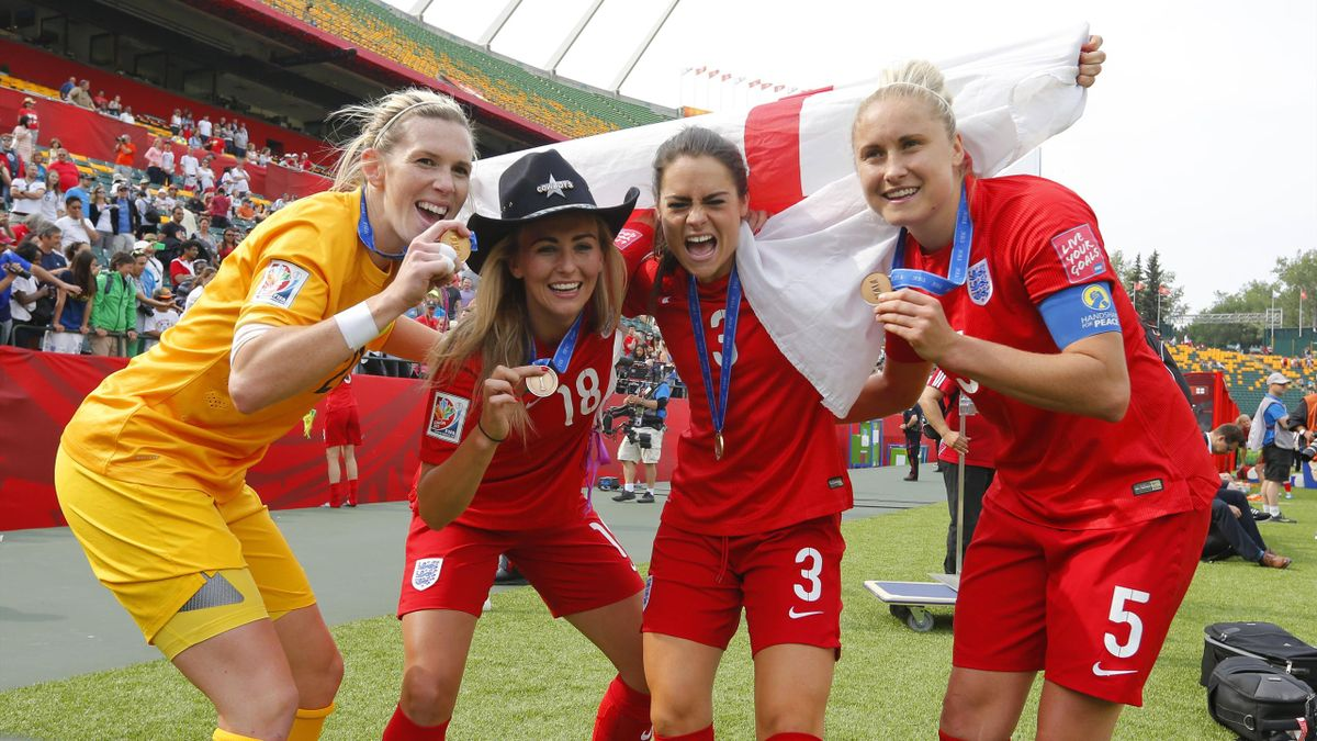 England goalkeeper Carly Telford (21) and forward Toni Duggan (18) and defender Claire Rafferty (3) and defender Steph Houghton (5) display their medals after defeating Germany in the third place match of the FIFA 2015 Women's World Cup