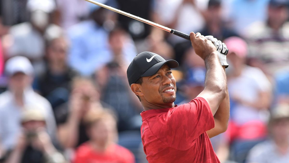 US golfer Tiger Woods watches his iron shot from the 3rd tee during his final round on day 4 of The 147th Open golf Championship at Carnoustie, Scotland on July 22, 2018.