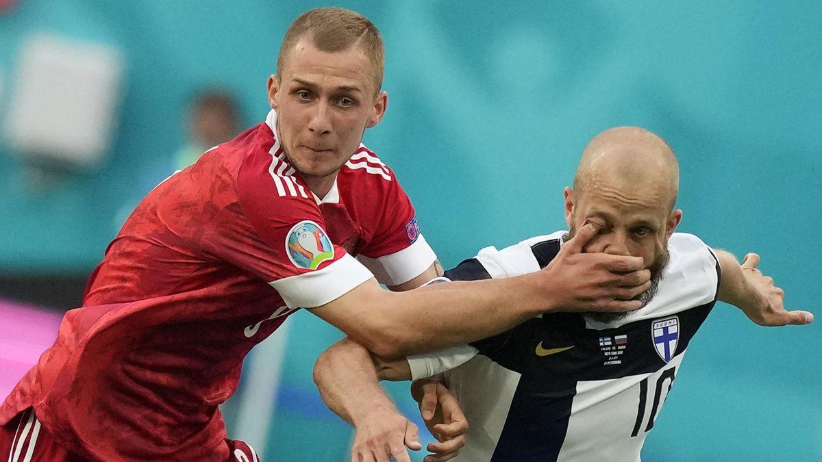 Russia's Dmitriy Barinov catches Finland's Teemu Pukki