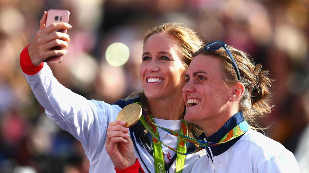 Helen Glover (L) and Heather Stanning (R) pose for a selfie during the Olympics & Paralympics Team GB - Rio 2016 Victory Parade at Trafalgar Square on October 18, 2016 in London, England.